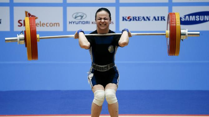 Kazakhstan's Margarita Yelisseyeva competes in the women's 48kg clean and jerk weightlifting competition at the Moonlight Festival Garden during the 17th Asian Games in Incheon