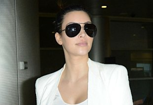 Kim Kardashian Reveals Sore Lip In Miami, Is It From A Special Kanye Kiss?