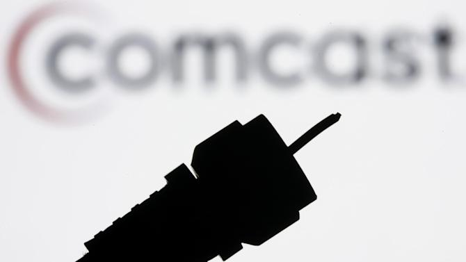 FILE - In this July 30, 2008 file photo illustration, a silhouetted coaxial cable is photographed with the Comcast Corp. logo in the background in Philadelphia.Comcast Corp. announced Thursday that it is buying Time Warner Cable Inc. for $45.2 billion in stock. The deal combines two of the nation's top pay TV and Internet service companies and makes Comcast, which also owns NBCUniversal, a dominant force in both creating and delivering entertainment to U.S. homes. (AP Photo/Matt Rourke, file)