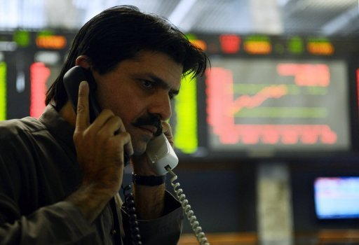<p>A Pakistani stockbroker at the Karachi Stock Exchange on December 31, 2012. Pakistan is offering to insure foreign businessmen in a bid to attract overseas investment.</p>