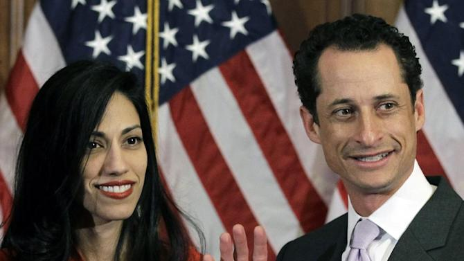 FILE - In this Jan. 5, 2011, file photo, Anthony Weiner and his wife Huma Abedin pose for photographs after the ceremonial swearing in of the 112th Congress on Capitol Hill in Washington. Abedin, who was notably absent five months later when Weiner resigned his congressional seat and admitted sending lewd Twitter photos to women, has been a key player in his surging mayoral run. She's appeared in his campaign launch video, raised tens of thousands of dollars and joined him on the campaign trail. (AP Photo/Charles Dharapak, File)