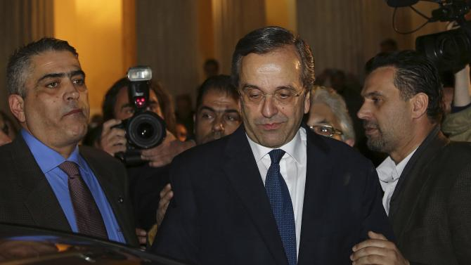 Outgoing Greek Prime Minister Samaras is seen after a news conference following an updated exit poll in Athens