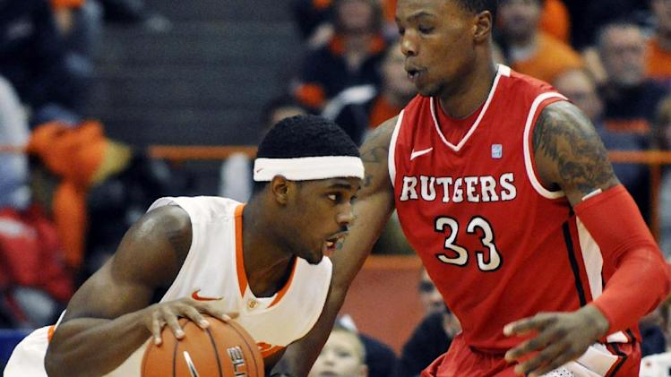 Syracuse's C.J. Fair, left, drives against Rutgers' Wally Judge during the first half of an NCAA college basketball game in Syracuse, N.Y., Wednesday, Jan. 2, 2013. (AP Photo/Kevin Rivoli)