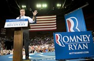 US Republican presidential candidate Mitt Romney holds a rally at Pensacola Civic Center in Pensacola, Florida. The approach of what could be the most devastating storm in decades threw a surprise into the US presidential contest as Barack Obama and Romney hunted for votes -- and took swipes at each other -- amid fears of chaos ahead of the November 6 election