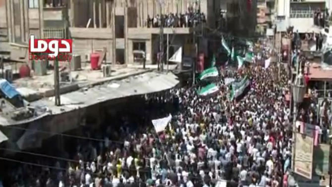 This image made from amateur video and released by Douma Revolution in Syria Friday, April 13, 2012 purports to show a large anti-government demonstration in Douma, Syria. (AP Photo/Douma Revolotion in Syria via AP video) THE ASSOCIATED PRESS CANNOT INDEPENDENTLY VERIFY THE CONTENT, DATE, LOCATION OR AUTHENTICITY OF THIS MATERIAL. TV OUT