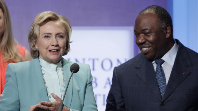 Former Secretary of State Hillary Rodham Clinton, left, is joined by Ali Bongo Ondimba, President of Gabon, at the Clinton Global Initiative, after announcing the Partnership to Save Africa's Elephants, Thursday, Sept. 26, 2013 in New York. The Wildlife Conservation Society, African Wildlife Foundation, Conservation International, the International Fund for Animal Welfare, and the World Wildlife Fund are collaborating in an $80 million pledge for the partnership. (AP Photo/Mark Lennihan)