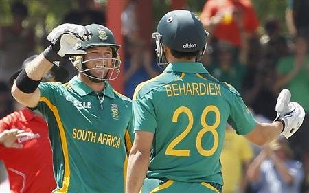 South Africa's Colin Ingram (L) celebrates his 100 runs with Farhaan Behardien during their One day international cricket match against Pakistan in Bloemfontein, March 10, 2013. REUTERS/Siphiwe Sibeko