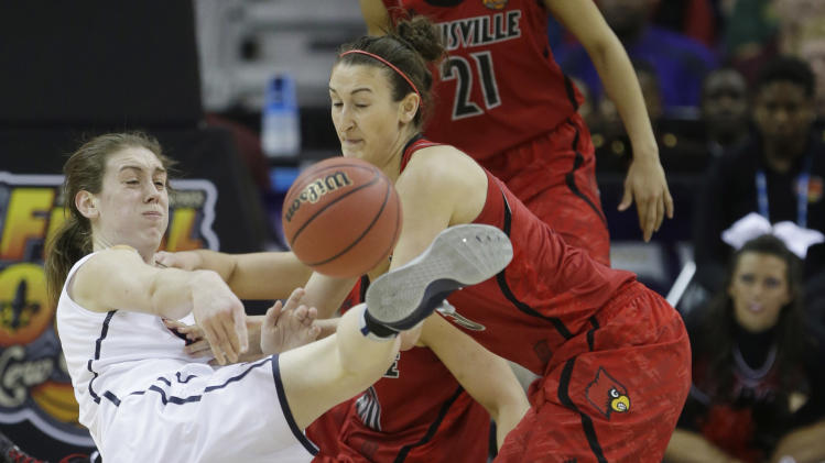 Connecticut forward Breanna Stewart (30) and Louisville guard Megan Deines (15) battle for a loose ball during first half of the national championship game of the women's Final Four of the NCAA college basketball tournament, Tuesday, April 9, 2013, in New Orleans. (AP Photo/Gerald Herbert)