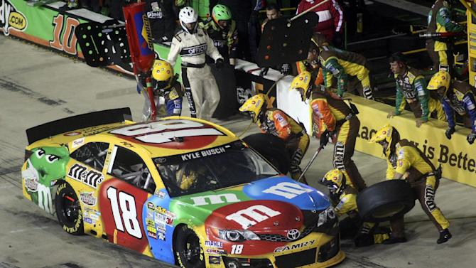 Kyle Busch pits during the Toyota Owner's 400 NASCAR Sprint Cup series auto race at Richmond International Raceway in Richmond, Va., Saturday April 27, 2013. (AP Photo/Jason Hirschfeld)