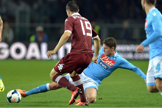 Napoli's Jorginho challenges Torino midfielder Nikola Maksimovic during a Serie A soccer match between at the Olympic  stadium, in Turin, Italy, Monday, March 17, 2014