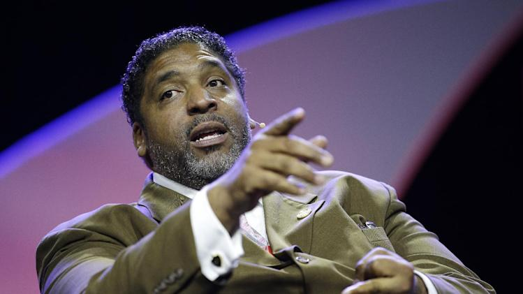 William Barber speaks during a panel discussion on black turnout for midterm elections and voter suppression during the NAACP annual convention Tuesday, July 22, 2014, in Las Vegas. (AP Photo/John Locher)