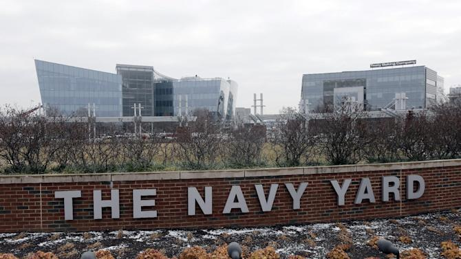 In this Wednesday, Feb. 6, 2013 photo, shown is the new GlaxoSmithKline building, top left, at the Navy Yard in Philadelphia. The city's Navy Yard is celebrating a milestone that skeptics might not have believed 15 years ago. Nearly all naval operations are long gone from the sprawling former shipyard but 10,000 people now work there in an eclectic mix of businesses from fashion to pharmacies. That number is expected to triple in 20 years. (AP Photo/Matt Rourke)