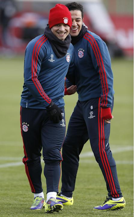 Bayern's Thiago Alcantara of Spain, background, jokes with team mate Xherdan Shaqiri of Switzerland during a last training session prior the Champions League group D soccer match between FC Bayern