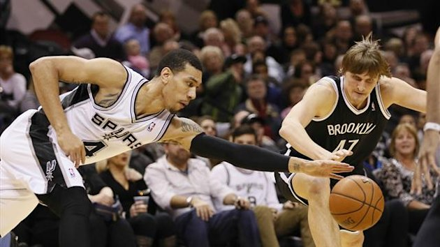 San Antonio Spurs guard Danny Green (4) attempts to steal the ball from Brooklyn Nets forward Andrei Kirilenko (right) during the first half at AT&T Center (Reuters)