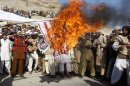 File photo of Afghan protesters burning a U.S. flag during a protest in Jalalabad province