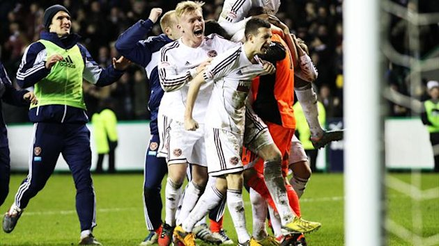 Hearts players celebrate a dramatic victory at Easter Road