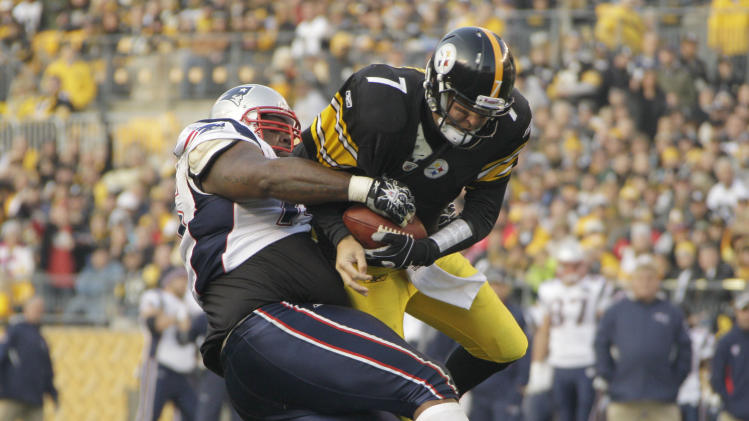 New England Patriots defensive tackle Vince Wilfork (75) tackles Pittsburgh Steelers quarterback Ben Roethlisberger (7) in the second quarter of the NFL football game on Sunday, Oct. 30, 2011, in Pittsburgh. (AP Photo/Gene J. Puskar)