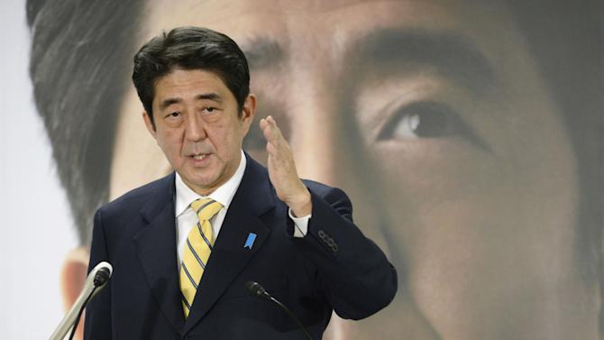 Japan's major opposition Liberal Democratic Party leader Shinzo Abe speaks during a news conference in Tokyo Wednesday, Nov. 21, 2012. Former Japanese Prime Minister Abe is vowing to spearhead economic recovery and strengthen Japan's military as he looks to regain leadership in elections next month. Abe, who resigned as prime minister in 2007 after a year in office due to a stomach ailment, is the most likely candidate to replace incumbent Yoshihiko Noda following Dec. 16 elections. (AP Photo/Kyodo News, File) JAPAN OUT, MANDATORY CREDIT, NO LICENSING IN CHINA, FRANCE, HONG KONG, JAPAN AND SOUTH KOREA