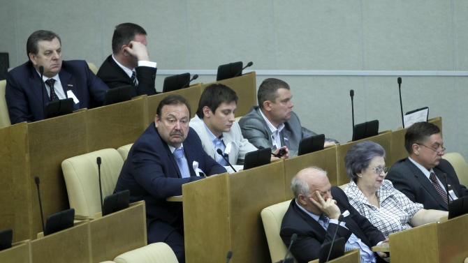 Members of the opposition Just Russia party wear white ribbons during a session of Russian parliament in Moscow, Russia, Tuesday, May 22, 2012. Just Russia members boycotted debates on a new bill introducing new tough sanctions against protesters. (AP Photo/Misha Japaridze)