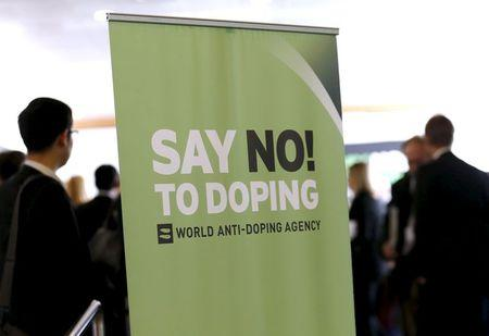 File photo of participants talking before the start of the WADA Symposium in Lausanne