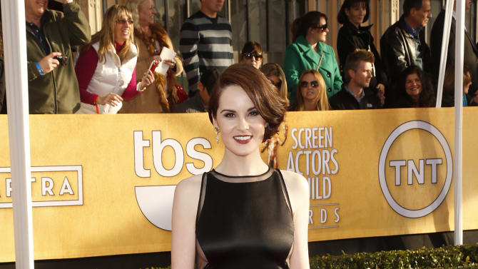 Michelle Dockery arrives at the 19th Annual Screen Actors Guild Awards at the Shrine Auditorium in Los Angeles on Sunday Jan. 27, 2013. (Photo by Todd Williamson/Invision for The Hollywood Reporter/AP Images)