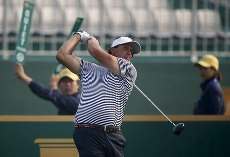 U.S. team member Mickelson tees off on the first hole during the practice round for the 2015 Presidents Cup golf tournament at the Jack Nicklaus Golf Club in Incheon