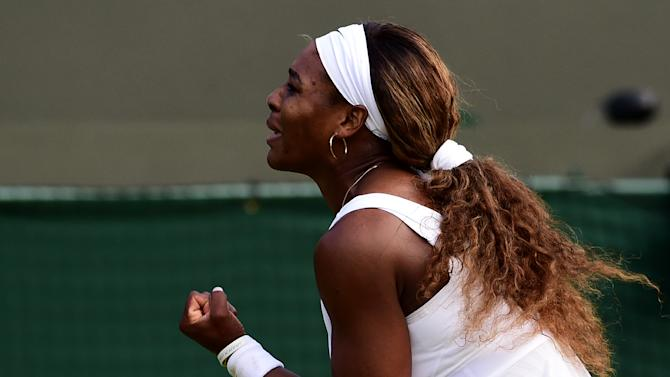US player Serena Williams reacts reacts to winning a point against France's Alize Cornet on day six of the 2014 Wimbledon Championships at The All England Tennis Club in Wimbledon, southwest London, on June 28, 2014