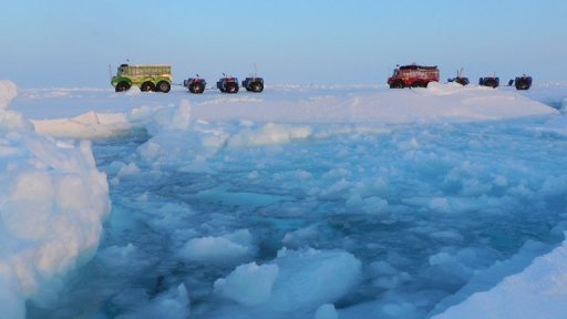 This undated image released by the Marine Ice Automobile Expedition, shows expedition members using trucks to cross the North Pole. Russia has ordered the urgent evacuation of the 16-strong crew of a drifting Arctic research station after ice floe that hosts the floating laboratory began to disintegrate, officials told AFP.
