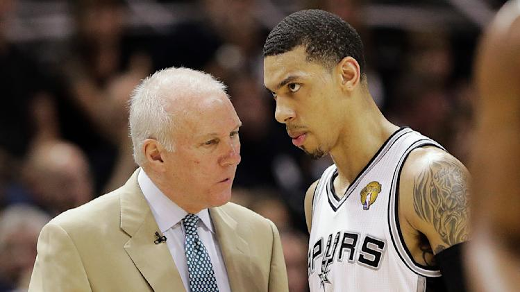 San Antonio Spurs' Gregg Popovich and Danny Green (4) talk at a break against the Miami Heat during the first half at Game 5 of the NBA Finals basketball series, Sunday, June 16, 2013, in San Antonio. (AP Photo/Eric Gay)