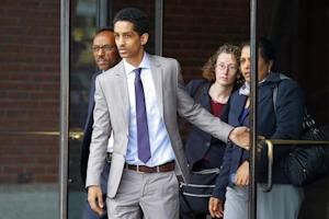 Robel Phillipos, a friend of suspected Boston Marathon bomber Dzhokhar Tsarnaev, who is charged with lying to investigators, leaves the federal courthouse after a hearing in his case in Boston