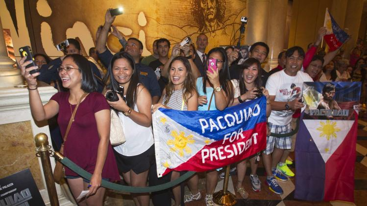Manny Pacquiao fans wait for him to pass by at the Venetian Las Vegas Resort in Nevada