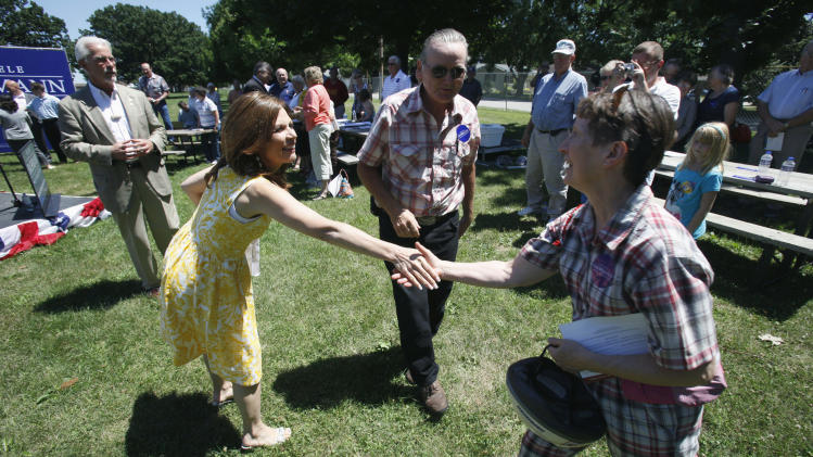 Republican presidential candidate, Rep. Michele Bachmann, R-Minn., greets Judy Ellingson, of Manchester, Iowa, right, before speaking at a rally at the Delaware County fairgrounds in Manchester, Iowa, Monday, July 25, 2011.  After months of playing nice Bachmann and fellow Minnesotan Tim Pawlenty have started criticizing each other, reflecting the importance of the next few weeks of campaigning leading to the Iowa Straw poll. (AP Photo/Charlie Neibergall)