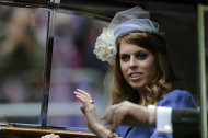 Britain's Princes Beatrice passes along The Mall for a service of thanksgiving at St Paul's Cathedral as part of Queen Elizabeth II Diamond Jubilee celebrations, London, Tuesday June 5, 2012. Queen Elizabeth II will make a rare address to the nation at the conclusion of festivities marking her 60 years on the throne. (AP Photo/Tom Hevezi)