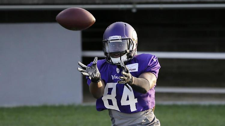 Minnesota Vikings wide receiver Cordarrelle Patterson (84) catches a pass over wide receiver Adam Thielen during an NFL football training camp practice, Monday, July 28, 2014, in Mankato, Minn