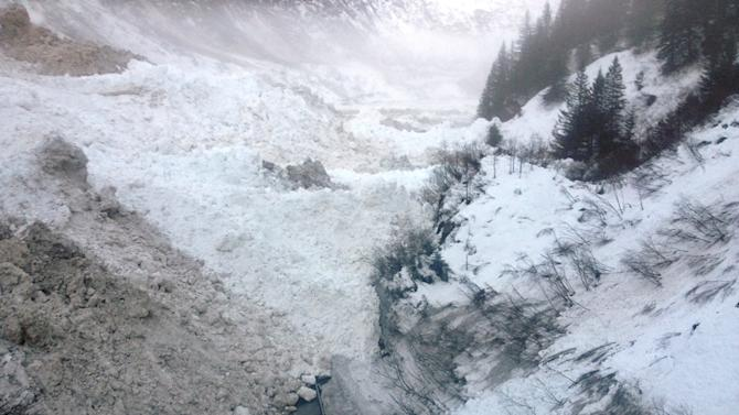 This Jan. 24, 2014 photo provided by the Alaska Department of Transportation & Public Facilities shows multiple avalanches that crossed the Richardson Highway in the Thompson Pass region of Valdez, Alaska on Friday Jan. 24, 2014. Alaska highway officials say the only highway into the city of 4,100 people will be closed until further notice, for at least a week, if not much longer. (AP Photo/Alaska Department of Transportation & Public Facilities)