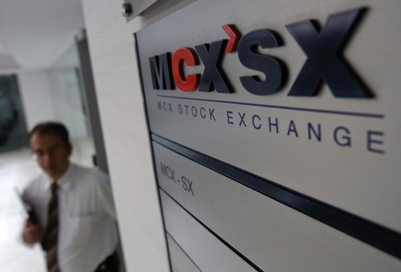 Staff member walks past MCX-SX logo in Mumbai
