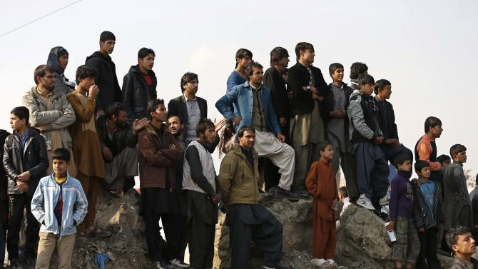 Afghans gather at the site of a suicide attack in Kabul