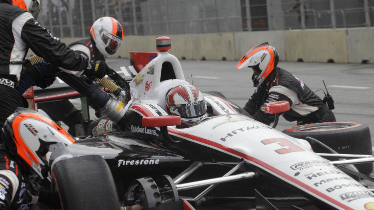 IndyCar driver Helio Castroneves, of Brazil, makes a pitstop during the IndyCar Sao Paulo 300 in Sao Paulo, Brazil, Sunday, May 5, 2013. (AP Photo/Nelson Antoine)