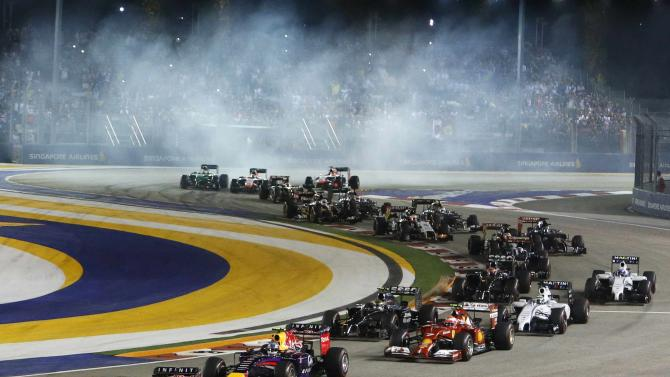 Mercedes Formula One driver Hamilton of Britain leads during the first lap of the Singapore F1 Grand Prix at the Marina Bay street circuit in Singapore