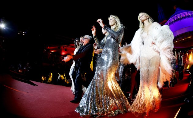 Italian fashion designer Roberto Cavalli arrives with models for the opening ceremony of the 21st Life Ball in Vienna