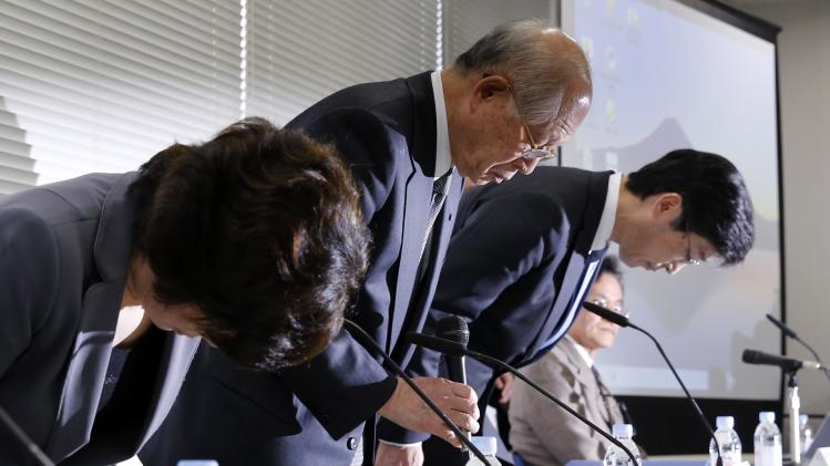 President of Japanese research institute Riken, Ryoji Noyori bows with other Riken executives during a news conference in Tokyo