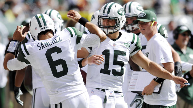 New York Jets quarterbacks Mark Sanchez, left, and Tim Tebow celebrate after a touchdown during the second half of an NFL football game against the Buffalo Bills at MetLife Stadium, Sunday, Sept. 9, 2012, in East Rutherford, N.J. (AP Photo/Bill Kostroun)