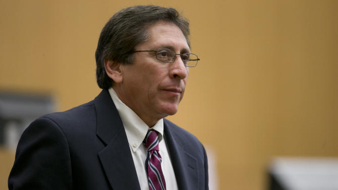Prosecutor Juan Martinez looks on during the cross examination of  Dr. Janeen DeMarte during the Jodi Arias trial at Maricopa County Superior Court in Phoenix on Wednesday, April 17, 2013.   Arias is on trial for the killing of her boyfriend, Travis Alexander in 2008.  Arias claims self-defense but faces a potential death sentence if convicted of first-degree murder.  (AP Photo/The Arizona Republic, David Wallace, Pool)