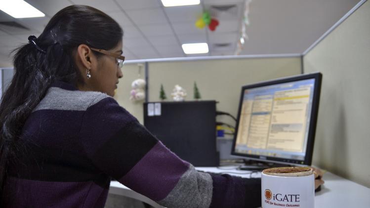 An employee works at the Indian headquarters of iGate in the southern Indian city of Bangalore