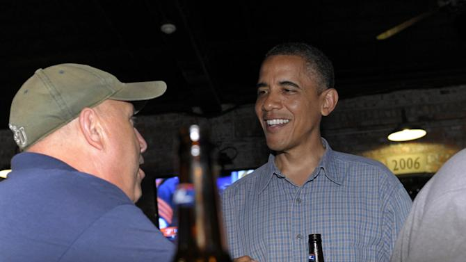 FILE - In this July 5, 2012 file photo, President Barack Obama has a beer as he talks with patrons as he stops for a beer at Ziggy's Pub and Restaurant in Amherst, Ohio. Obama and his team frequently talk about the president's fondness for beer, and Obama has been photographed many times downing a beer, including an appearance at the Iowa State Fair last month. Being identified as a beer drinker is an easy way for Obama to connect with votes and serves as a not-so-subtle reminder that his Republican rival Mitt Romney, a Mormon, doesn't drink.  (AP Photo/Susan Walsh, File)