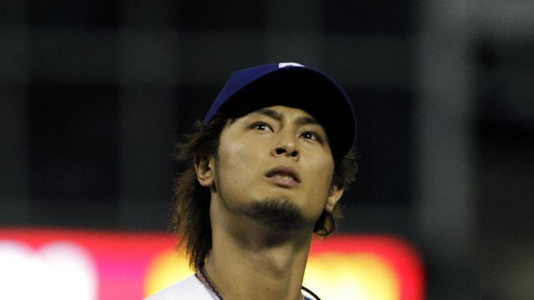 Texas Rangers' Yu Darvish walks off the field following the top of the fourth inning of a baseball game against the New York Yankees on Tuesday, April 24, 2012, in Arlington, Texas. (AP Photo/Tony Gutierrez)
