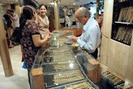 Indian women buy gold jewellery at a shop in New Delhi in 2009. Global demand for gold fell 5.0 percent in the first quarter of 2012 but demand in China hit record highs and outstripped that of megabuyer India, the World Gold Council said