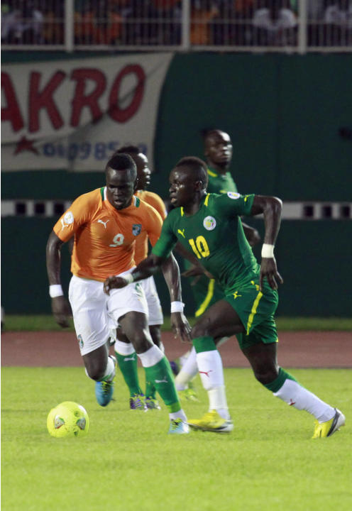 Ivory Coast's Tiote fights for the ball with Senegal's Mane during their 2014 World Cup qualifying soccer match in Abidjan