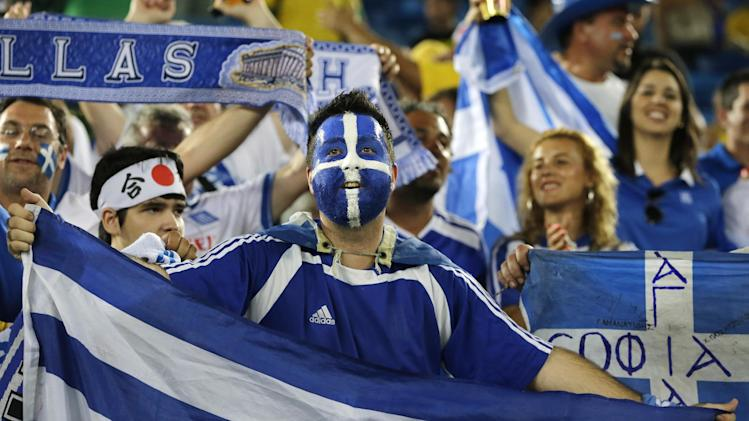 Greek fans wait for the start of the group C World Cup soccer match between Japan and Greece at the Arena das Dunas in Natal, Brazil, Thursday, June 19, 2014