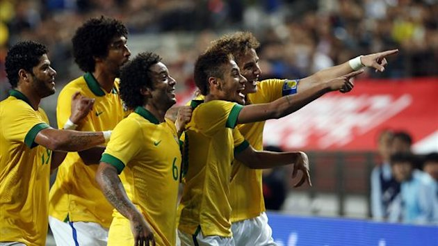 Brazil's Neymar (2nd R) celebrates with his teammates after he scored a goal against South Korea